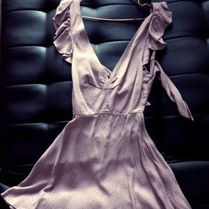 ruffle detail tie back dress